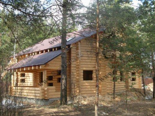 Дом из оцилиндрованного бревна из кедра
